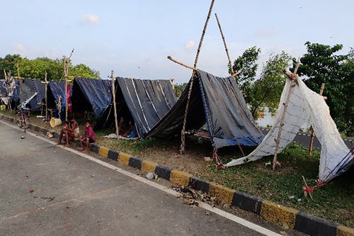 Makeshift tents line a street in flood-affected Bihar.
