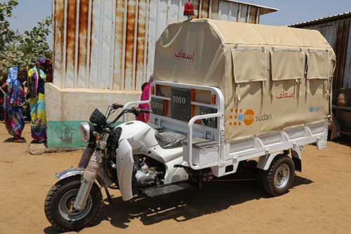 A motorcycle ambulance, called a tuk-tuk, is being provided to the local community.