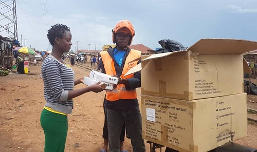 A SafeBoda driver delivers reproductive health commodities.