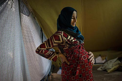 Many refugees and migrants in Greece have serious reproductive health  needs. Photo by Lynsey Addario for Time.