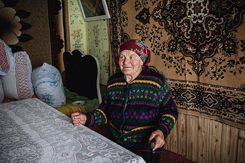 Maria Rosca sits in her home in Moldova.
