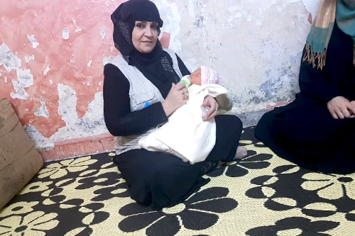 https://www.unfpa.org/sites/default/files/Midwive_Hanan_wz_new_baby_born_embed.jpg