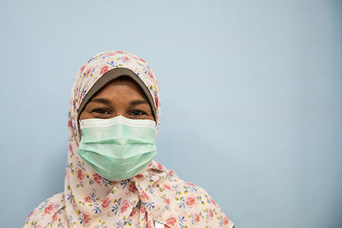 Nashwa Mohamed wears a face mask and hijab in the family planning unit.