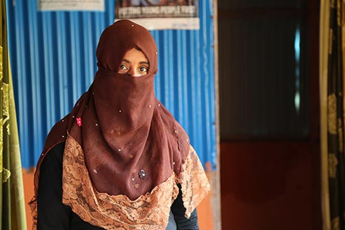 Rokeya stands in a women-led community centre.
