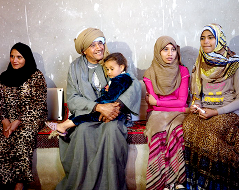 An Egyptian family sits inside their home.