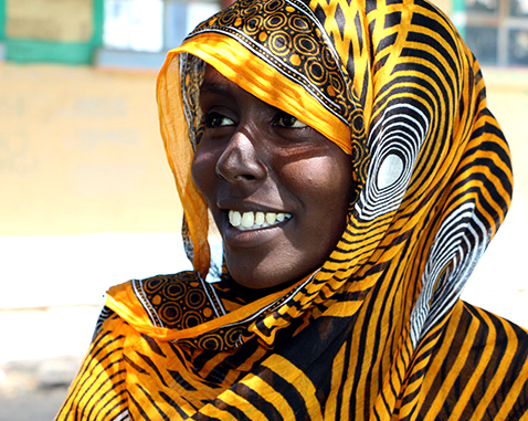 A young woman in bright yellow headscarf.