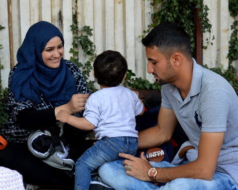 A young Syrian family on the border between Greece and Macedonia.