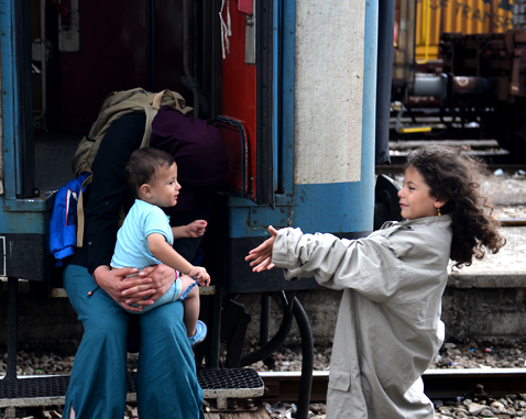 A Syrian family at a train yard.