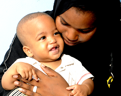 A young mother holds her child.