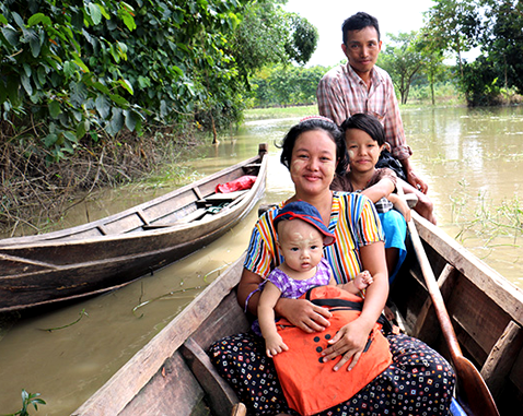 A family in a canoe after severe flooding.