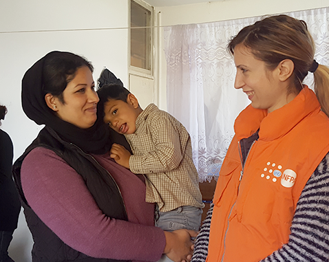 A refugee woman and her son meet with UNFPA staff.