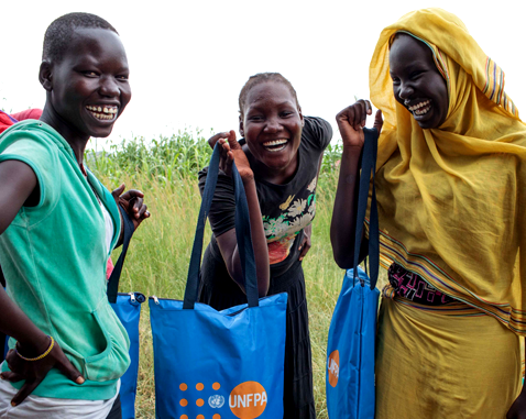 Adolescent girls with UNFPA Dignity Kits.