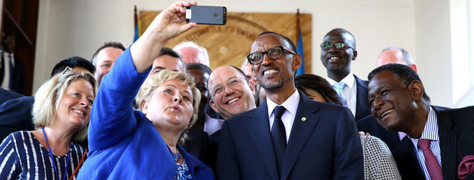 Participants in the MDG Advocates meeting, in Kigali, take a selfie. Included are (left-right) Norwegian Prime Minister Erna Solberg, Rwandan President Paul Kagame, and UNFPA Executive Director Dr. Babatunde Osotimehin. Photo credit: Paul Kagame/Flickr