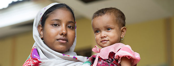 Rahae Na Bagum, 19, holds her 18-month-old baby at Dai Pai Hospital in Rakhine State, in September 2013, before humanitarian staff were evacuated following attacks in March 2014. Photo credit: UNFPA Myanmar