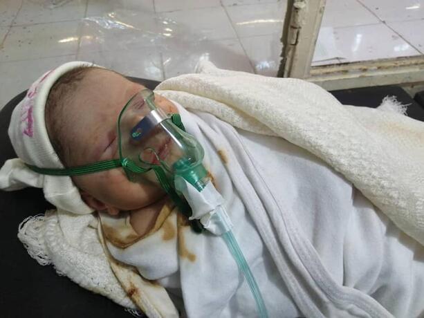 A newborn baby boy.