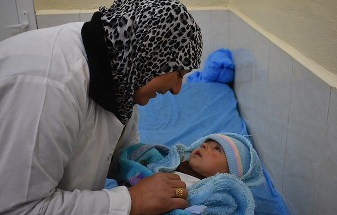 Um Qassem continued her work as a midwife, even as ISIL fighters took over the hospital. © UNFPA Iraq