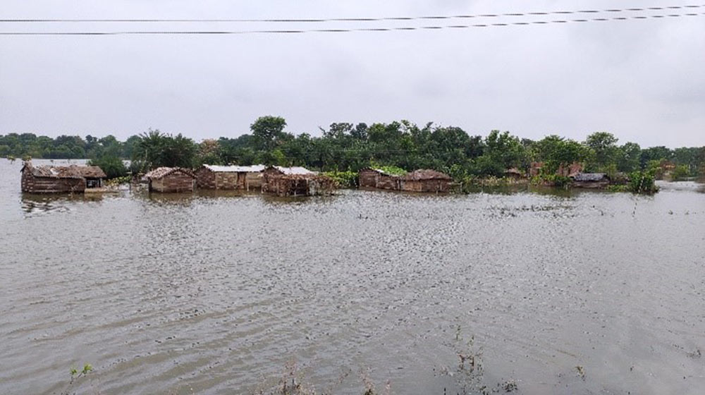 Houses are submerged in floodwaters in Bihar State.