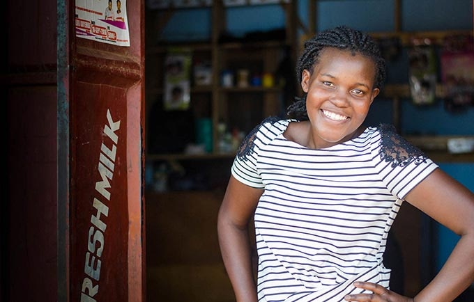 Edith Nambalirwa is reaching other youth with her entrepreneurial spirit and knowledge of sexual and reproductive health. © UNFPA ESARO/Corrie Butler