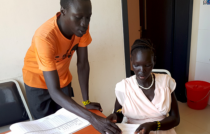 Elizabeth Ayumpou Balang speaks with a midwife during her antenatal check-up at the Kiir Mayardit Women's Hospital in Rumbek. ©UNFPA South Sudan/Arlene Alano