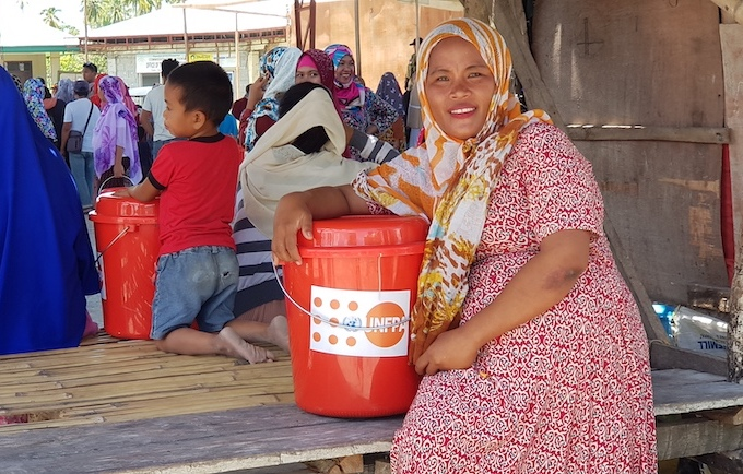 Eight months pregnant and mother of six, Nadia Muson and her family were within earshot of the armed conflict in their municipality of Datu Salibo, Maguindanao. © UNFPA Philippines/ Rochelle Yu
