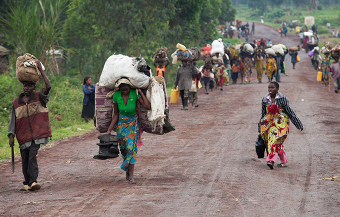 Residents flee brutal violence in the Rutshuru territory of the Democratic Republic of the Congo, in 2012. Women give birth, even in wartime and disasters. © UN Photo/Sylvain Liechti