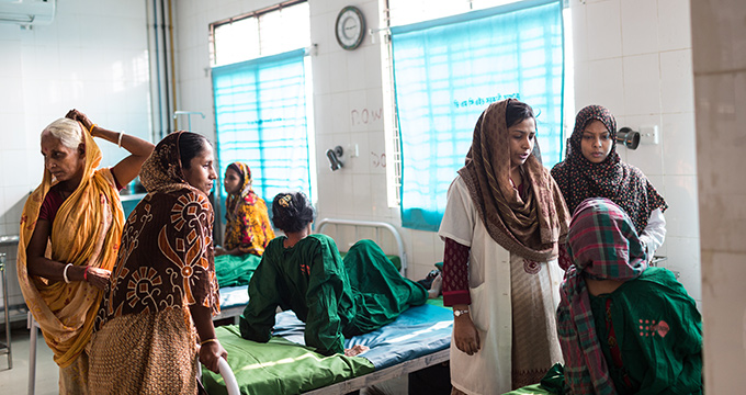 Dr. Nazneen Begum and Dr. Ruksana Khanum check on patients at the National Management Centre for Obstetric Fistula. For many women suffering from obstetric fistula, treatment is not enough. Skills training and counselling are essential to overcoming the stigma and isolation related to the condition. © Nicolas Axelrod/Ruom for UNFPA