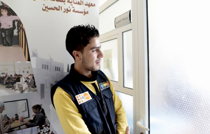 Amir nearly died while fleeing Syria. Today, he works at a UNFPA-supported health centre, helping other refugees seek assistance. © UNFPA Jordan/David Brunetti