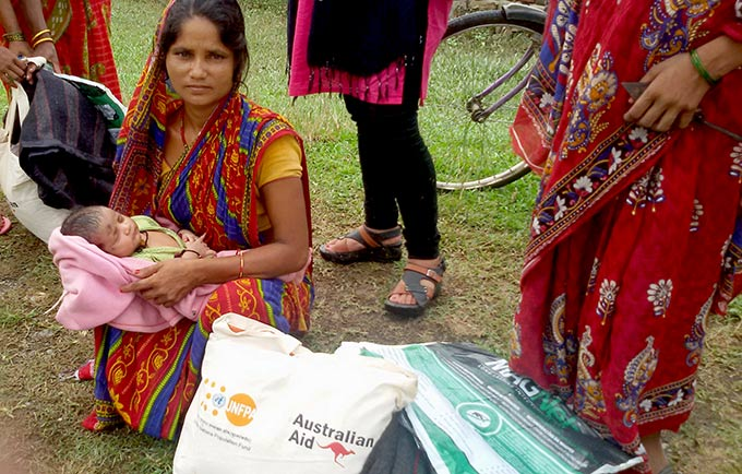 Babita Rishidev waded for hours in murky floodwaters, carrying her 38-day-old infant. © UNFPA Nepal/Hari Bhusal
