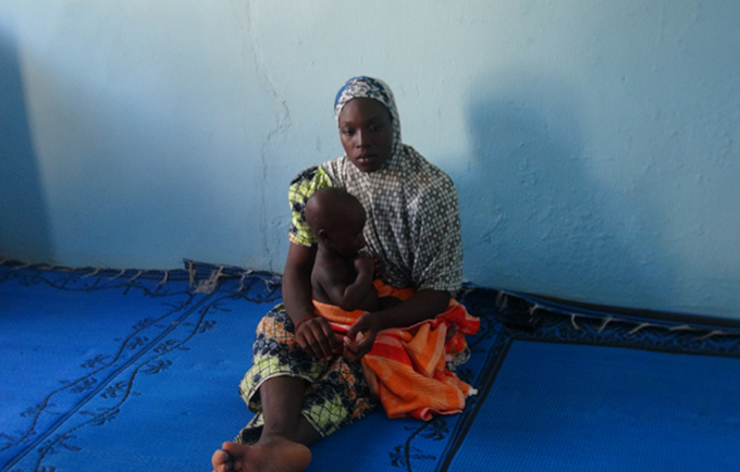 Hauwa gave birth to her son while escaping Boko Haram. Now, they are receiving health and counselling services at a rehabilitation centre in Maiduguri. © UNFPA Nigeria/Kori Habib