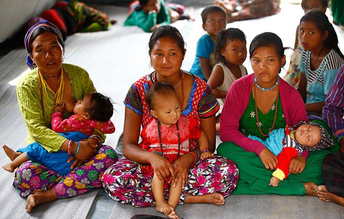 Nangsal Tamang, Kalpana Tamang, and Dawa Deki Tamang, all from Hakku Village, receive care at a mobile reproductive health camp in Rasuwa District. © UNFPA Nepal