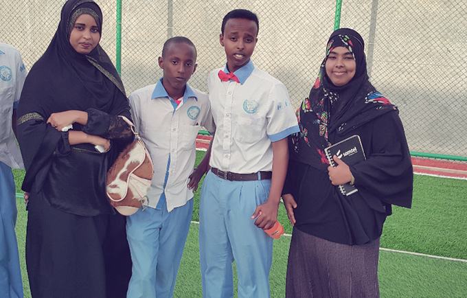 Fatima Abdi Ali (right) with other young people. Ms. Abdi Ali, 21, serves on the country's Youth Advisory Panel, promoting the role of young people in establishing a sustainable peace in Somalia. © Y-Peer Somalia