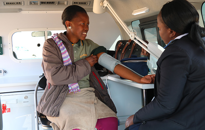 'Mantina Mphohle receiving health services inside a new mobile clinic, near the factory where she works. © UNFPA Lesotho
