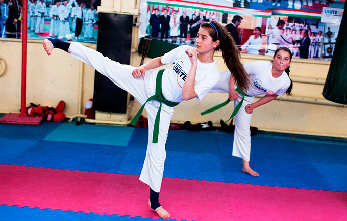 Girls practice Taekwondo in Dushanbe. They are wearing t-shirts from the UN Secretary-General's UNiTE to End Violence against Women campaign. Sports federations in Tajikistan are working to advance gender equality and prevent violence against women. © UNFPA Tajikistan/Panos Pictures/William Daniels