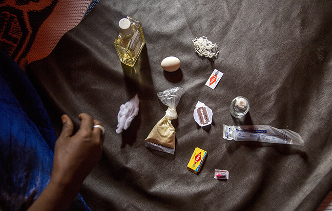 Asha lays out the tools she uses to perform female genital mutilation in Somalia. © UNFPA/Georgina Goodwin
