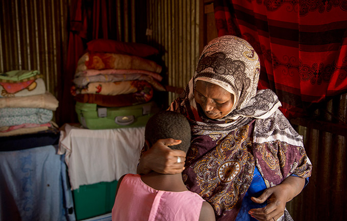 Asha Ali Ibrahim, a local circumciser, with her granddaughter, who is due to be cut this year. © UNFPA/Georgina Goodwin