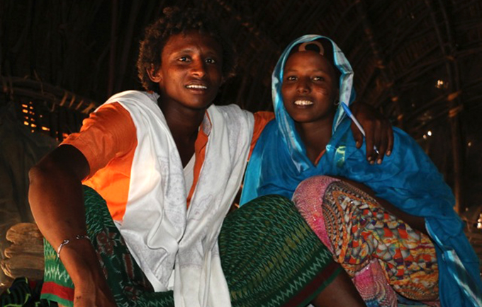 Hawa Buha with her husband, Enehaba Seid, in their home in Ethiopia. Ms. Hawa has been a trailblazer in her community, first refusing to undergo FGM, then marrying for love. © UNFPA Ethiopia/Abraham Gelaw