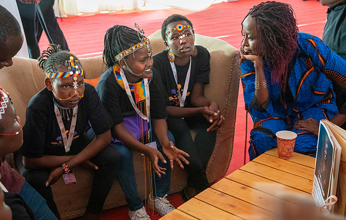 Survivors and advocates Nachaki, Rosillah and Eunice speak with advocate and psychotherapist Leyla Hussein at the Nairobi Summit on ICPD25. (L-R) Photo courtesy of Elizabeth Pratt/Too Young to Wed.