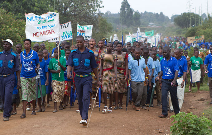 Community members march against FGM. They are graduates and supporters of a rite of passage that serves as an alternative to FGM. © UNFPA/Mandela Gregoire