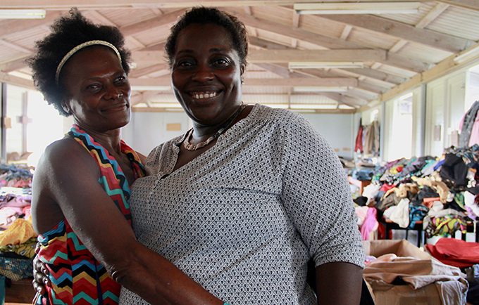 At the shelter at the National Technical Training Centre, resident Dediemay Thomas (left) stands with manager Samantha Burnette. © UNFPA/Katheline Ruiz