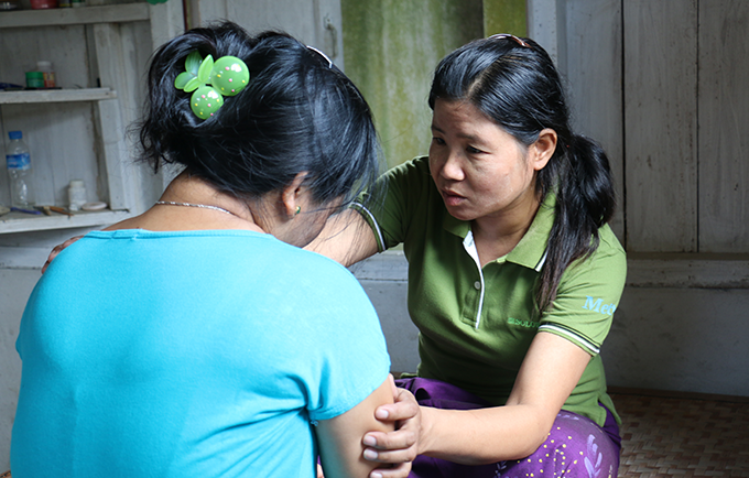 """The most difficult part of my job is the repeated cases, where the husband will not change his behaviour, where the wife is not able to leave, and where she is abused again and again,"" says caseworker Lu Bu. © UNFPA/Yenny Gamming"
