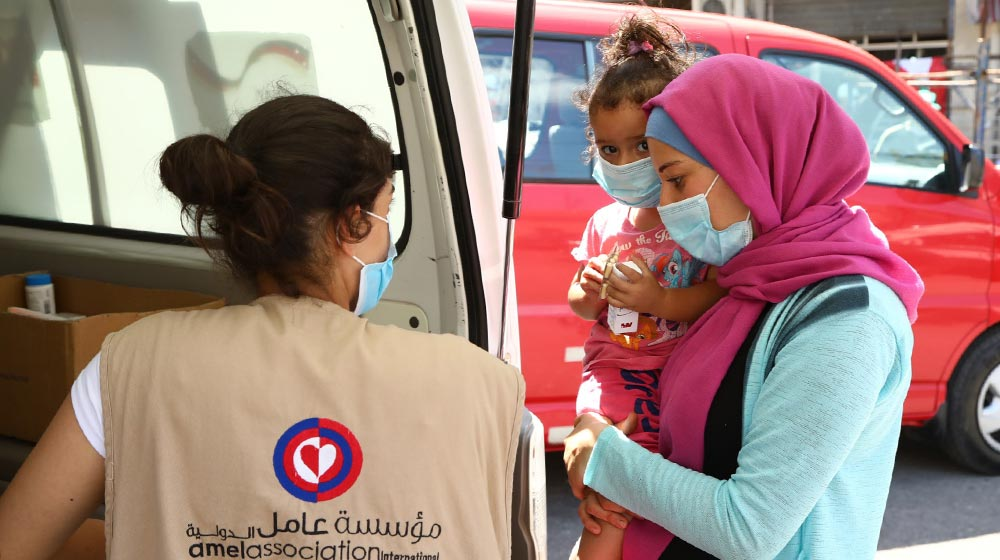 Beirut residents receive support from a mobile medical unit run by Amel Association, with support from UNFPA.