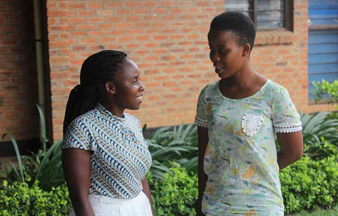 University students Prisca Gama and Given Mwira teach women and girls about the menstrual cup, and say there has been keen interest. © Henry Chimbali/UNFPA Malawi