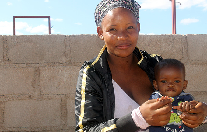 Rose Matuulane, 24, with one of her children. She is able to access antenatal care, cervical cancer screening, HIV testing and family planning counselling all in the same clinic visit. © UNFPA Botswana/Nchidzi Smarts