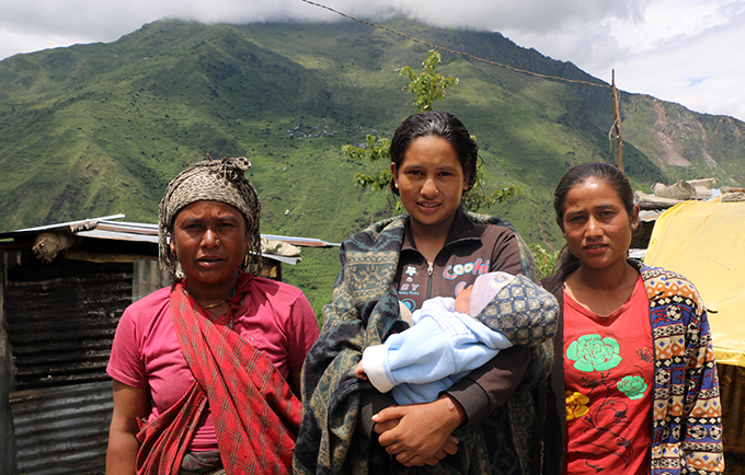 Shreejana (centre) with her baby, mother and sister outside their temporary shelter in Goljung Village, Nepal. Health facilities in earthquake-affected areas sustained tremendous damage. © UNFPA Nepal/Santosh Chhetri