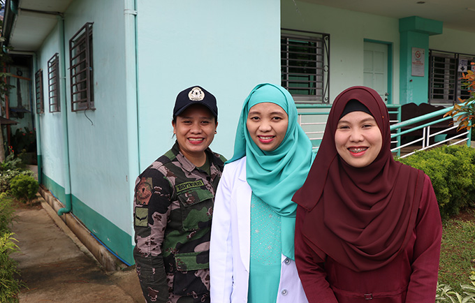 Police Officer Chrestine Espinorio, Dr. Nadhira Abdulcarim and social worker Umme Limbona work together to support survivors of violence at a hospital-based crisis centre. © UNFPA Philippines/Mario Villamor