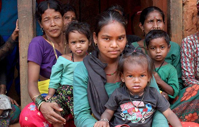 Three women with their children in Far Western Nepal. All of the women were child brides. © UNFPA Nepal/Santosh Chhetri