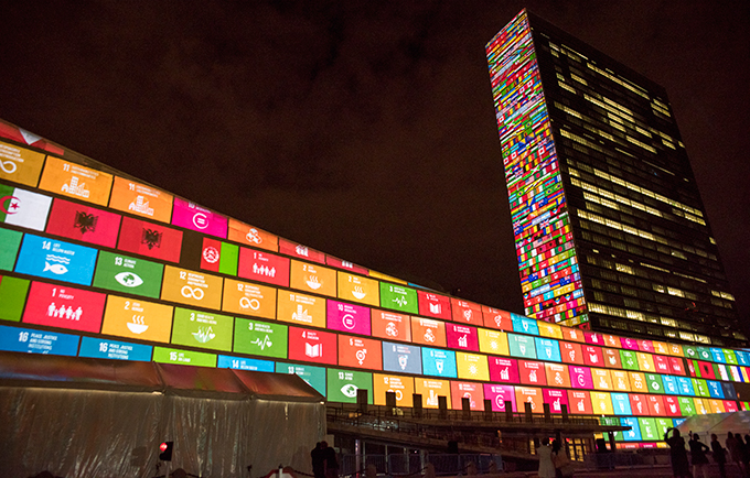The 17 Sustainable Development Goals are projected onto the United Nations building ahead of the Sustainable Development Summit. © UN Photo/Cia Pak