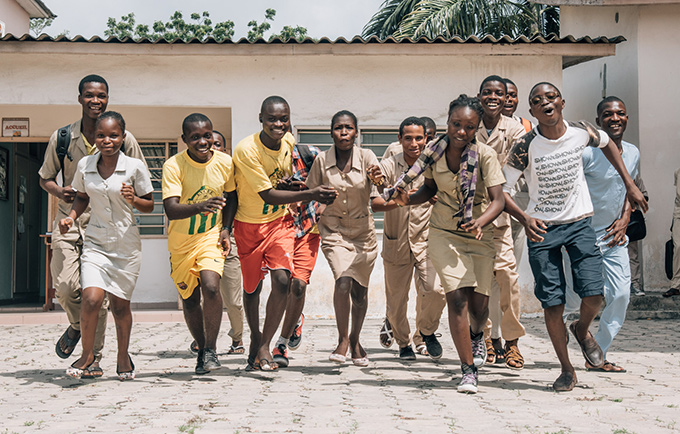 Much of the world is poised to reap a demographic dividend. But to do this, countries must invest in young people. Students in Cotonou, Benin. © UNFPA Benin/Ollivier Girard