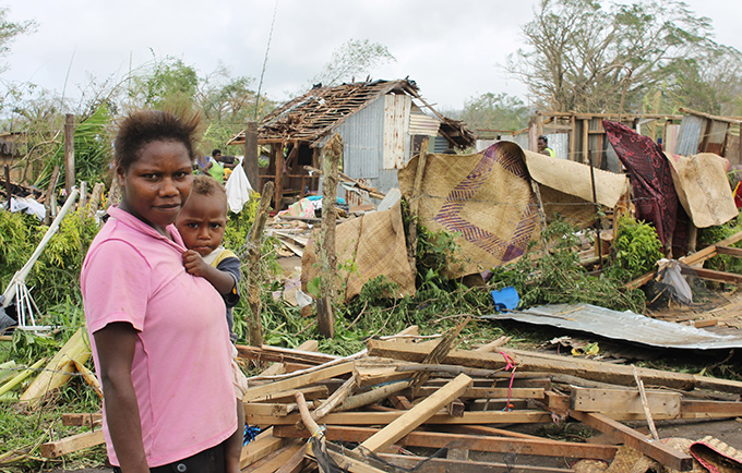 Thousands have been affected by the destruction caused by Cyclone Pam. A woman and child on the road to Mele, near Port Vila, the capital. © UNICEF/UNI181138/Crumb