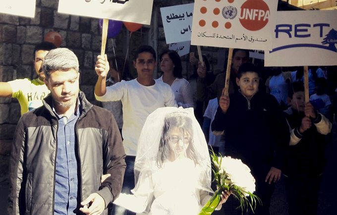 A girl dresses as a bride for a march against child marriage and gender-based violence in Jezzine, Lebanon. © RET Liban